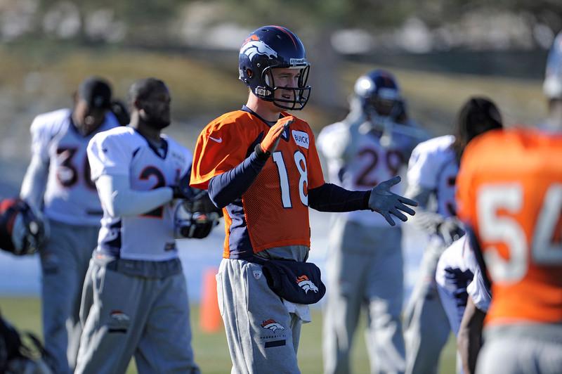 . Denver Broncos quarterback Peyton Manning (18) claps his hands before the start of practice Thursday, December 20, 2012 at Dove Valley.  John Leyba, The Denver Post
