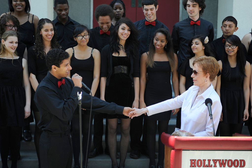 """. Students from H2O sing to Carol Burnett, award-winning actress, comedienne and best-selling author, was honored by the City of Los Angeles for her lifetime achievements with the naming of Carol Burnett Square at the intersection of Highland Avenue and Selma Avenue. The Square is adjacent to Hollywood High School where Burnett attended. Students from the school choir, \""""H2O\"""" sang �I�m so glad we had this time together,� before Burnett and LA City Councilman Tom LaBonge unveiled her street sign. Hollywood, CA 4/18/2013(John McCoy/Staff Photographer"""