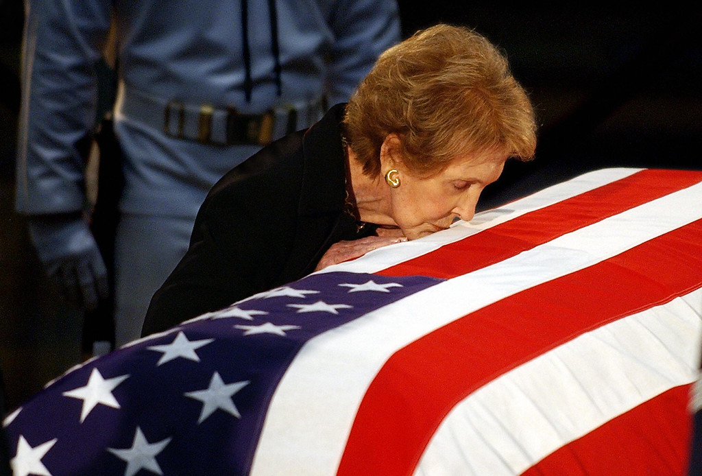 . Nancy Reagan kisses the casket containing the remains of her husband, US ex-president Ronald Reagan, at the Capitol rotunda shortly before he was taken away for a state funeral ceremony at the National Cathedral in Washington, DC, June 11, 2004. (ROBERTO SCHMIDT/AFP/Getty Images)