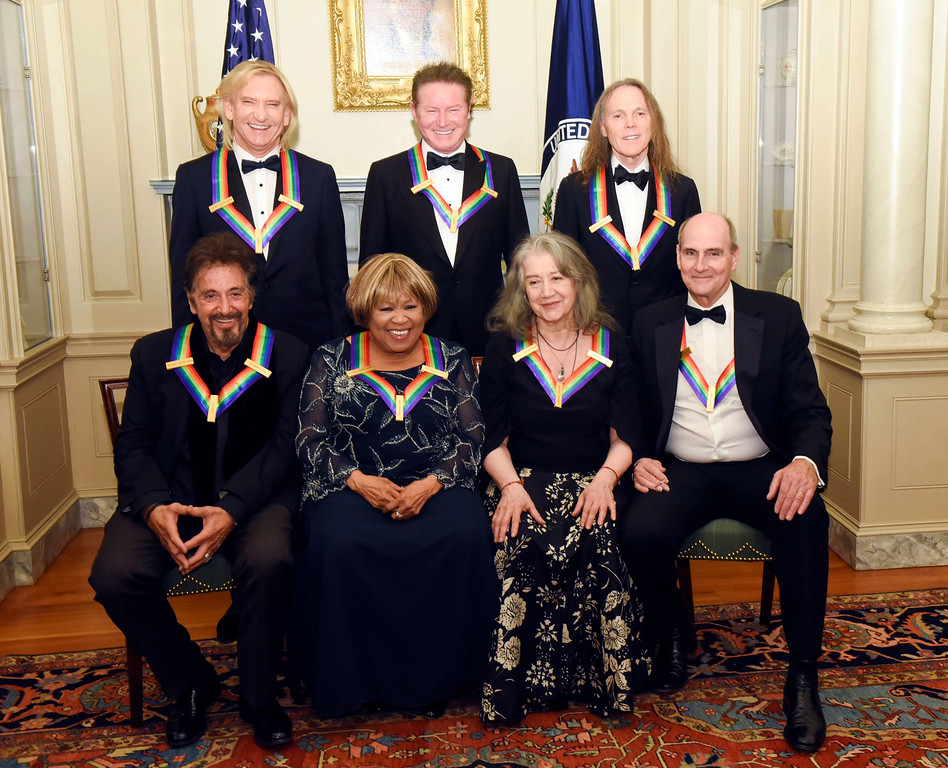 . The 2016 Kennedy Center Honorees, front row, from left, Al Pacino, Mavis Staples, Martha Argerich and James Taylor, back row, from left, Joe Walsh, Don Henley and Timothy Schmit are photographed at the State Department for the Kennedy Center Honors gala dinner, Saturday, Dec. 3, 2016, in Washington. (AP Photo/Kevin Wolf)