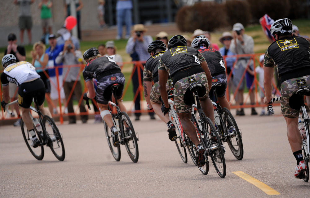 . Competitors make the 1st of 3 laps in the men\'s 30k upright cycling race.  The fourth annual Warrior Games cycling event took started and finished at Falcon Stadium on the grounds of the Air Force Academy in Colorado Springs, CO on May 12, 2013.  HRH Prince Harry was on hand to start the race as well as to hand out medals at the finish line.   A total of 260 wounded, ill and injured service members and veterans came to compete in the week long games.  Members of the Army, Marine Corps, Navy/Coast Guard/Air Force. Special Operations and the British Armed Forces all took part in the competition.  Other events included in the Warrior Games are shooting, sitting volleyball, track & field and wheelchair basketball.  (Photo by Helen H. Richardson/The Denver Post)