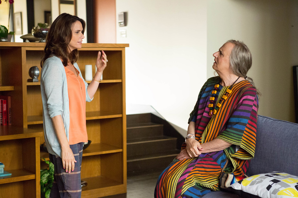 """. In this image released by Amazon Digital, Amy Landecker, left, and Jeffrey Tambor appear in a scene from \""""Transparent.\""""Tambor was nominated for a Golden Globe for best actor in a comedy series for his role in ì Transparentì, on Thursday, Dec. 11, 2014. The 72nd annual Golden Globe awards will air on NBC on Sunday, Jan. 11.  (AP Photo/Amazon Digital, Beth Dubber)"""