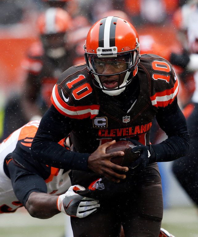 . Cleveland Browns quarterback Robert Griffin III runs the ball in the first half of an NFL football game against the Cincinnati Bengals, Sunday, Dec. 11, 2016, in Cleveland. (AP Photo/Ron Schwane)