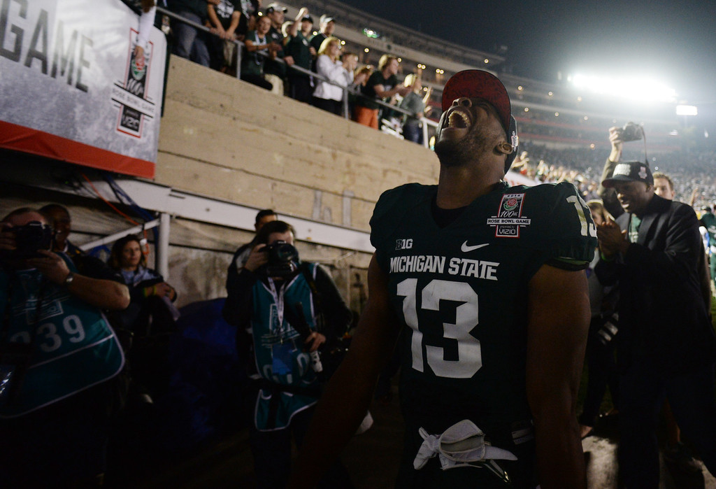 . Michigan State\'s Bennie Fowler #13 reacts as he walks in to the locker room after winning the 100th Rose Bowl game in Pasadena Wednesday, January 1, 2014. Michigan State defeated Stanford 24-20. (Photo by Hans Gutknecht/Los Angeles Daily News)