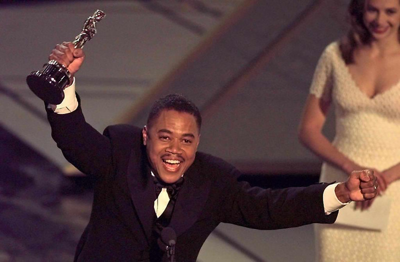". Actor Cuba Gooding, Jr holds up his Oscar after winning the Best Supporting Actor Award for his role in ""Jerry Maguire\"" during the 69th Academy Awards 24 March.  The awards are being held in the Shrine Auditorium. TIMOTHY A. CLARY/AFP/Getty Images"