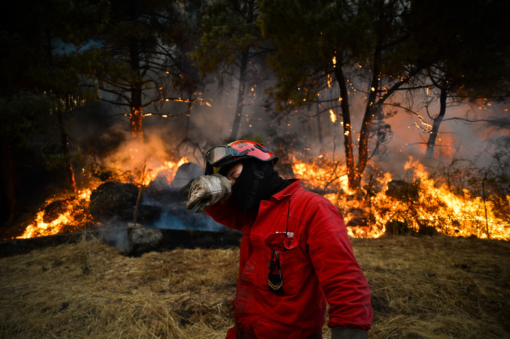 . A firefighter rubs his face during a wildfire in Caramulo, central Portugal on August 29, 2013.  AFP PHOTO / PATRICIA DE MELO MOREIRA/AFP/Getty Images