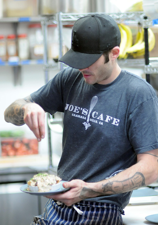 """. Chef Joe Wetherbee seasons a dish at Joe\'s Cafe in Granada Hills, CA on Wednesday, March 19, 2014.  Chef and Co-owner Joe Wetherbee won the Food Network\'s \""""Chopped, \""""Dread and Breakfast\"""" episode which aired on Tuesday night.  (Photo by Dean Musgrove/Los Angeles Daily News)"""