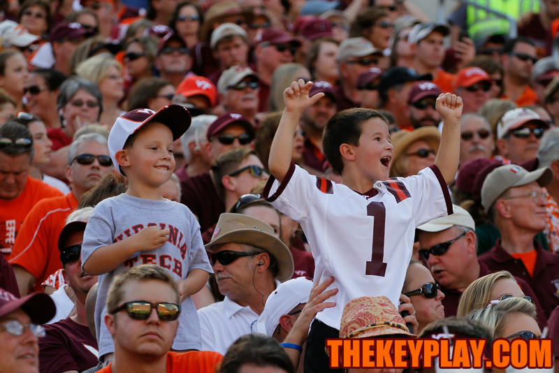 A couple Hokie fans cheer on the team from the West Stands.
