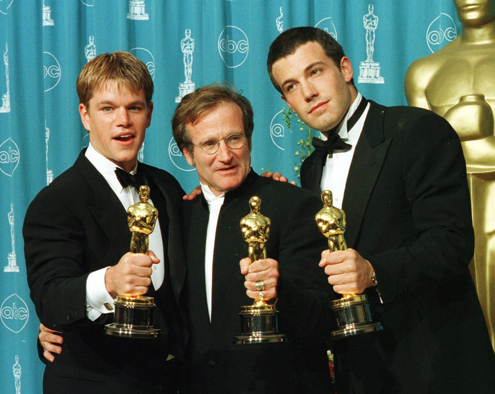 ". Actors-writers Matt Damon (L) and Ben Affleck (R) pose with actor Robin Williams with their Oscars they won for ""Good Will Hunting\"" at the 70th Annual Academy Awards 23 March in Los Angeles.  Damon and Affleck won Best Original Screenplay and Williams won for Best Supporting Actor.  (Photo credit should read HAL GARB/AFP/Getty Images)"