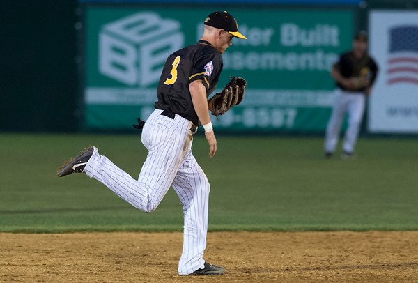 08/15/19 Wesley Bunnell | Staff The New Britain Bees vs the High Point Rockers at New Britain Stadium on Thursday, August 15, 2019. Short stop Ryan Jackson (8) checks his glove after making a running catch.