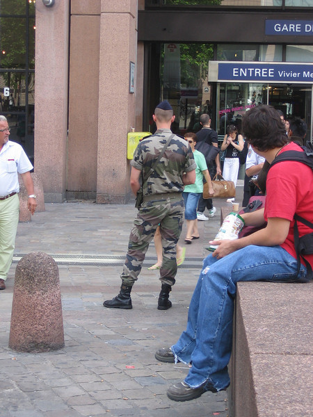 In France, train stations are patrolled by military with machine guns. They wander around in groups of 3 with huge guns, looking very stern. Location - Lyon