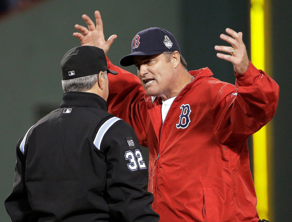 . Boston Red Sox manager John Farrell argues a call with umpire Dana DeMuth during the first inning of Game 1 of baseball\'s World Series against the St. Louis Cardinals  Wednesday, Oct. 23, 2013, in Boston. (AP Photo/David J. Phillip)