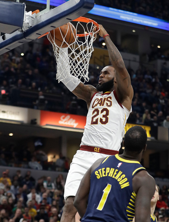 . Cleveland Cavaliers\' LeBron James (23) dunks against Indiana Pacers\' Lance Stephenson during the first half of an NBA basketball game Friday, Dec. 8, 2017, in Indianapolis. (AP Photo/Darron Cummings)
