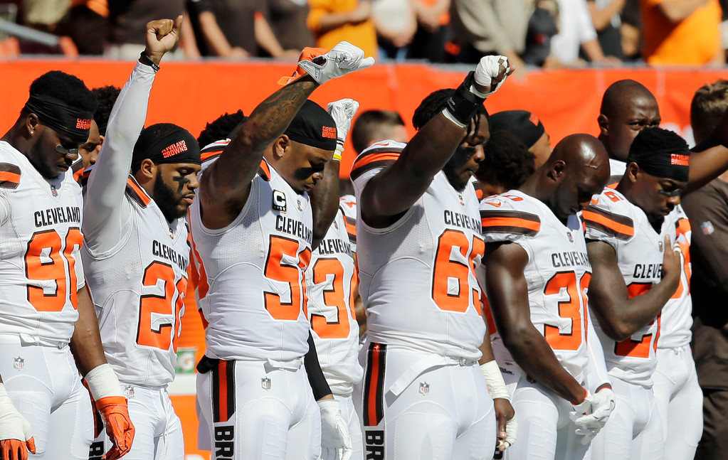 . Cleveland Browns players raise their fists during the national anthem before an NFL football game against the Cincinnati Bengals, Sunday, Oct. 1, 2017, in Cleveland. (AP Photo/Tony Dejak)