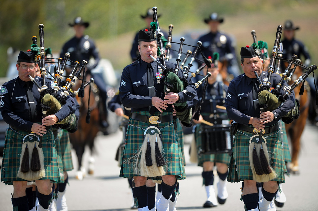 . Bagpipers lead the funeral procession for LAPD officer Chris Cortijo, Tuesday, April 22, 2014, at Forest Lawn Hollywood Hills. (Photo by Michael Owen Baker/L.A. Daily News)