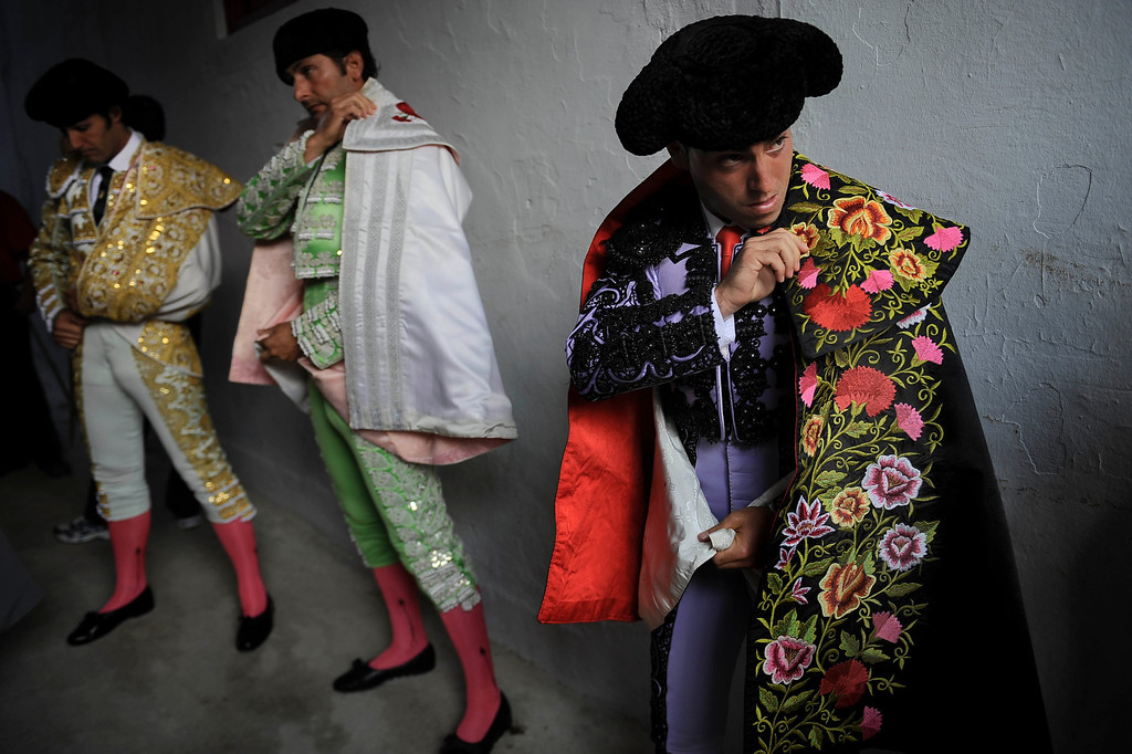 . Spanish bullfighter David Mora, left, prepares with assistants before entering the bullring at the San Fermin fiestas, in Pamplona, northern Spain on Thursday, July 11, 2013. (AP Photo/Alvaro Barrientos)
