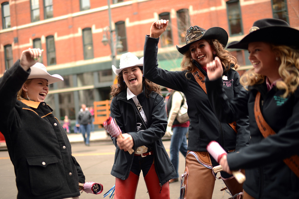 . From left, Rodeo Queens Kelly Arbogast, 17, Mandi Lawson, 18, Katie Goodson, 19, and Shelly Gillis, 19,  celebrate 107th National Western Stock Show Kick-Off Parade with the dance at Downtown Denver on Thursday, Denver, CO, January 10, 2013.  Hyoung Chang, The Denver Post