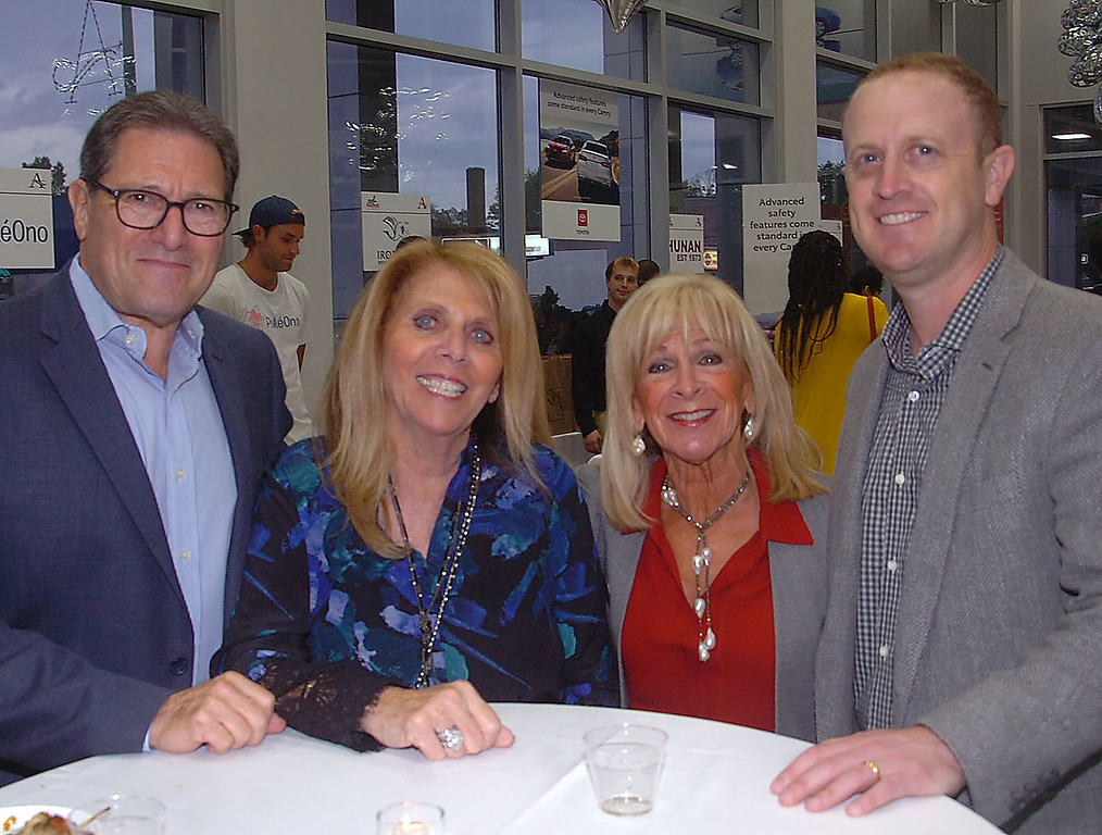. Steve and Amy Gaylon of Haverford  spend a moment with Susie  Pesin and her son Ryan Pesin, during Ardmore Initative\'s  \'A Taste of Ardmore\' last week. The event was held at Ardmore Toyota where Ryan Pesin is Vice-President.
