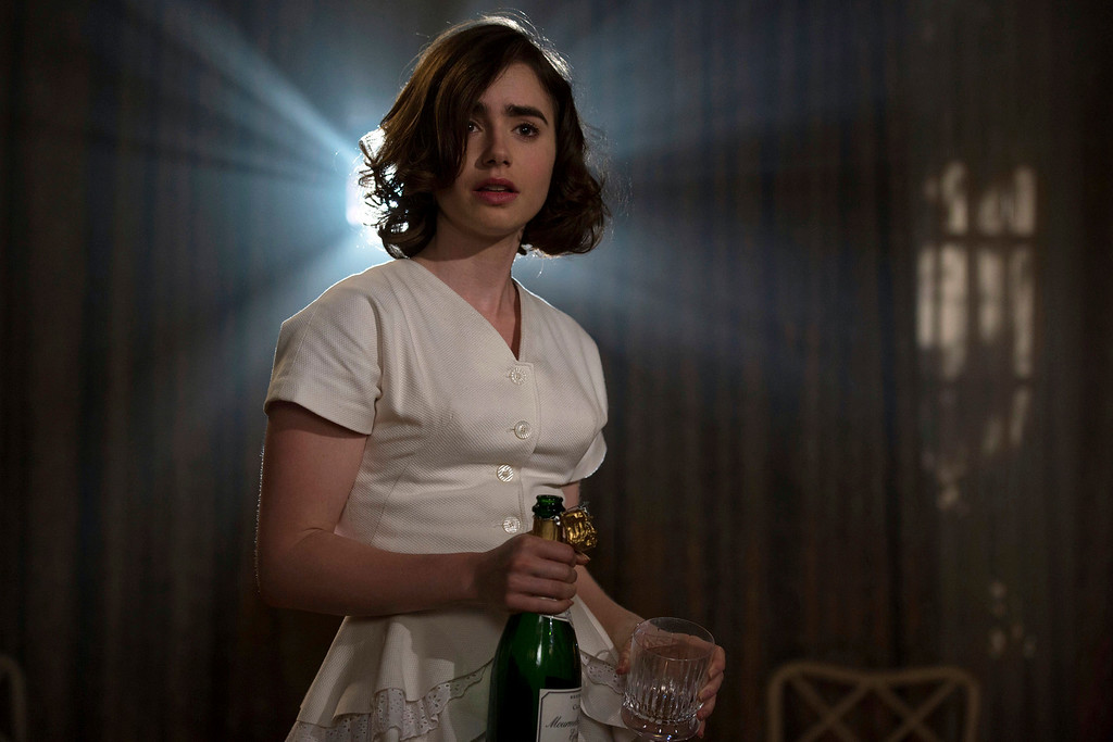 ". Lily Collins appears in a scene from ""Rules Don\'t Apply,\"" in theaters now. (Francois Duhamel/Twentieth Century Fox via AP)"