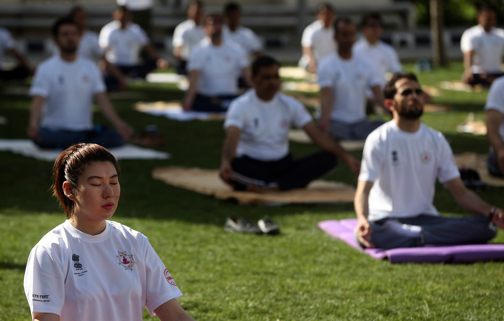 . Afghans and foreigners perform yoga to mark International Yoga Day at the Indian Embassy, in Kabul, Afghanistan,Wednesday, Jun 21, 2017. Thousands of yoga enthusiasts took part in mass yoga programs to mark International Yoga Day throughout the world. (AP Photo/Massoud Hossaini)