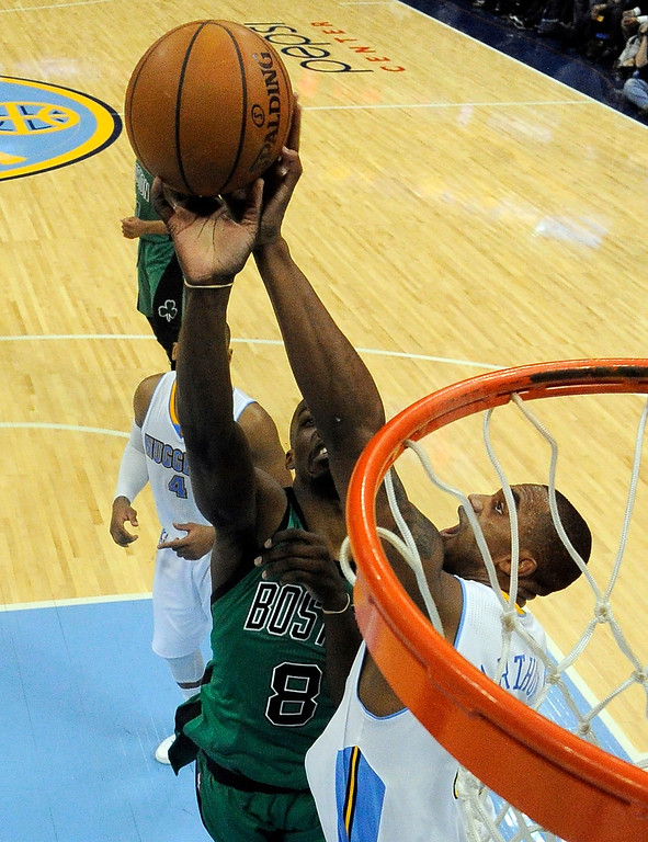 . Denver Nuggets power forward Darrell Arthur (00) blocks a shot by Boston Celtics small forward Jeff Green (8) during the third quarter January 7, 2014 at Pepsi Center. (Photo by John Leyba/The Denver Post)