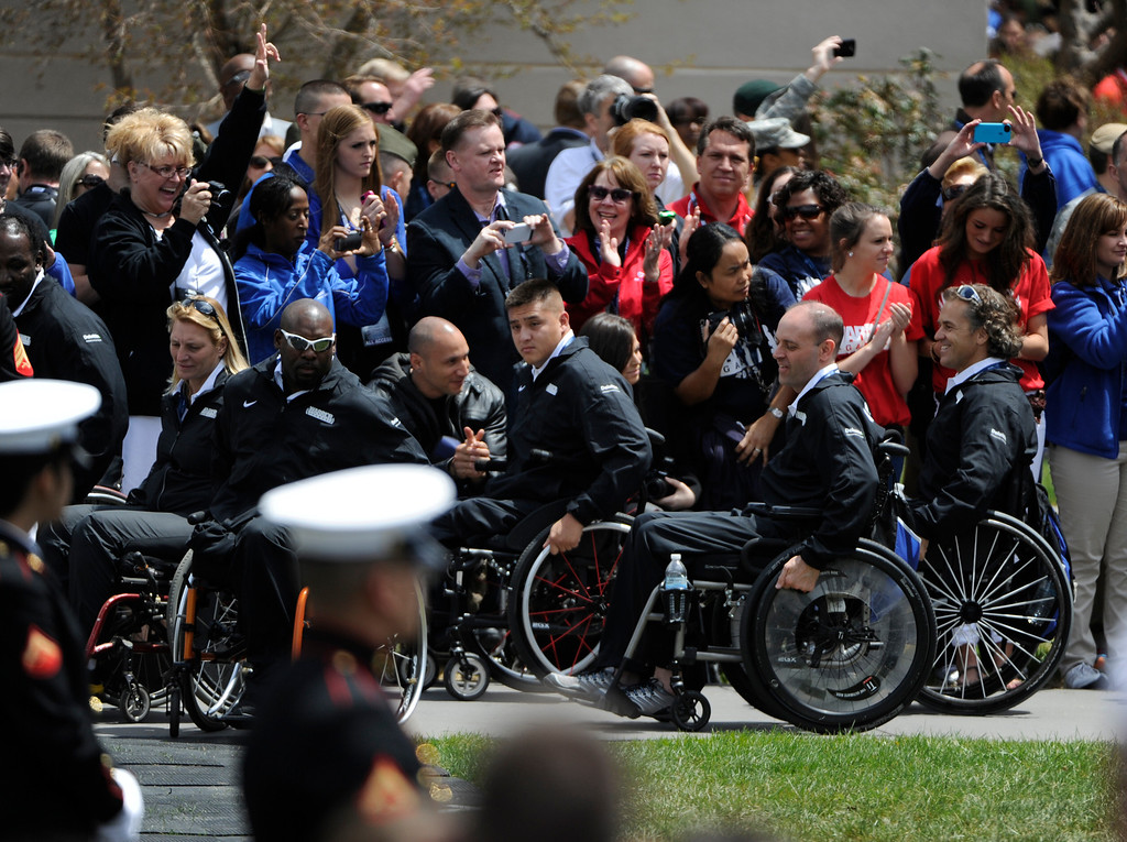 . COLORADO SPRINGS, CO - MAY 11: U.S. Army athletes arrive for the 2013 Warrior Games opening ceremonies at the United States Olympic Training Center  Saturday afternoon, May 11th, 2013.(Photo By Andy Cross/The Denver Post)