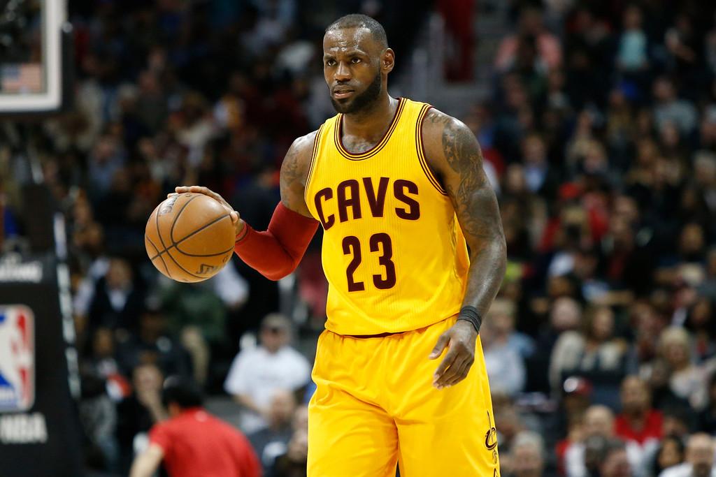. Cleveland Cavaliers forward LeBron James (23) dribbles against the Atlanta Hawks in the second half of an NBA basketball game, Friday, March 3, 2017, in Atlanta. The Cavaliers won 135-130. (AP Photo/Brett Davis)