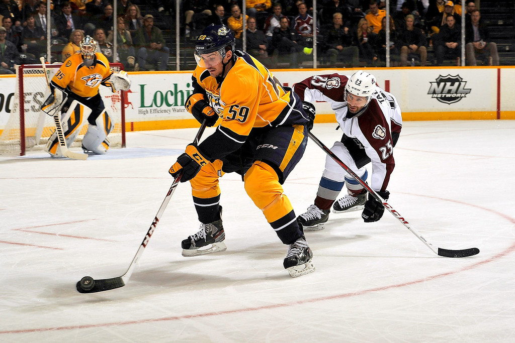 . Roman Josi #59 of the Nashville Predators skates against Maxime Talbot #25 of the Colorado Avalanche at Bridgestone Arena on March 25, 2014 in Nashville, Tennessee.  (Photo by Frederick Breedon/Getty Images)