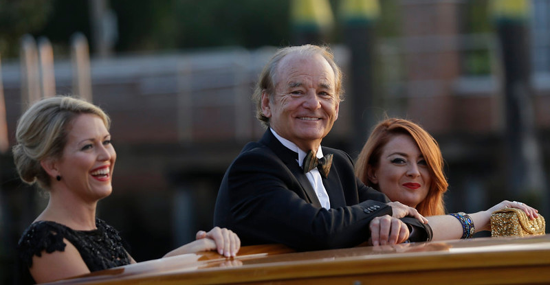 . Actor Bill Murray smiles from a boat prior to the George Clooney and Alma Amal Alamuddin wedding in Venice, Italy, Saturday, Sept. 27, 2014. (AP Photo/Luca Bruno)
