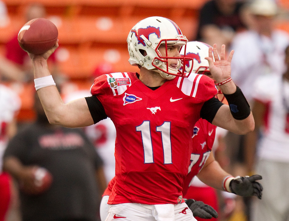 . SMU quarterback Garrett Gilbert drops back to pass against Fresno State in the third quarter of the Hawaii Bowl, an NCAA college football game Monday, Dec. 24, 2012, in Honolulu. (AP Photo/Eugene Tanner)