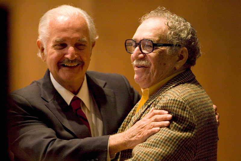 . In this Nov. 18, 2008 file photo, Mexican writer Carlos Fuentes, left, embraces Colombian author Gabriel Garcia Marquez during a round table discussion on Fuentes\' work at the UNAM national university in Mexico City. Marquez died Thursday April 17, 2014 at his home in Mexico City. (AP Photo/Dario Lopez-Mills, File)