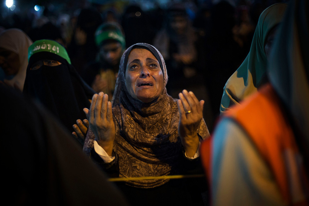 . A supporter of Egypt\'s ousted President Mohammed Morsi reacts while praying during a protest against Egyptian Defense Minister Gen. Abdel-Fattah el-Sissi  in Nasr City, Cairo, Egypt, Friday, Aug. 2, 2013. (AP Photo/Manu Brabo)