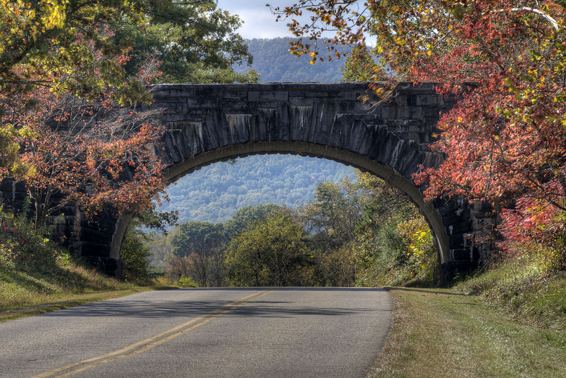 A stone bridge crosses the parkway, with a view of the mountains and fall foliage, at Milepost 116 on the Blue Ridge Parkway in Virginia on Friday, October 25, 2013. Copyright 2013 Jason Barnette