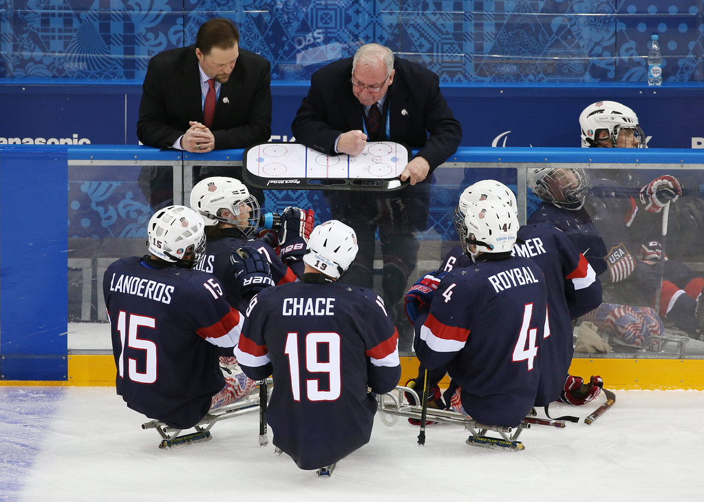 . Head coach of the US team Jeff Sauer(C) gives his instructions to the players during a time out during their group stage  Ice Sledge Hockey match against Russia at Sochi 2014 Paralympic Games, Russia, 08 March 2014.  EPA/SERGEI CHIRIKOV