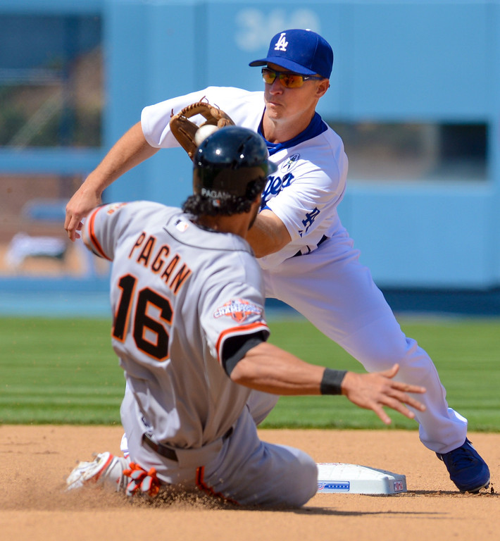 . Dodger\'s Mark Ellis tagged out Giant\'s Angel Pagan on this steal attempt during opening day at Dodger Stadium Monday.  Photo by David Crane/Los Angeles Daily News.