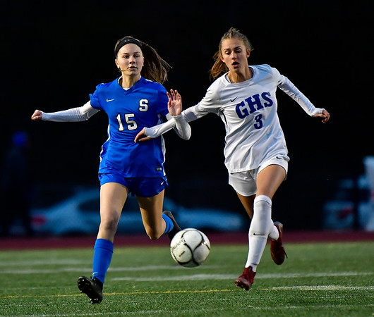 11/23/2019 Mike Orazzi | StaffrGlastonbury High School's Jaci Budaj (3) and Southington High School's Brianna Linehan (15) during the Class LL Girls State Soccer Tournament at Veterans Stadium in New Britain Saturday evening. Glastonbury defeated Southington 1-0. r