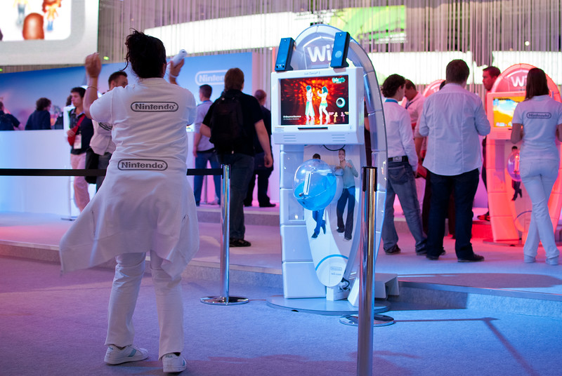 Girl playing Wii at GamesCom 2011