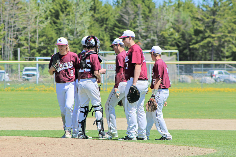The infield confers on the mound, down against Dexter on May 20. Photo by Anne Berleant