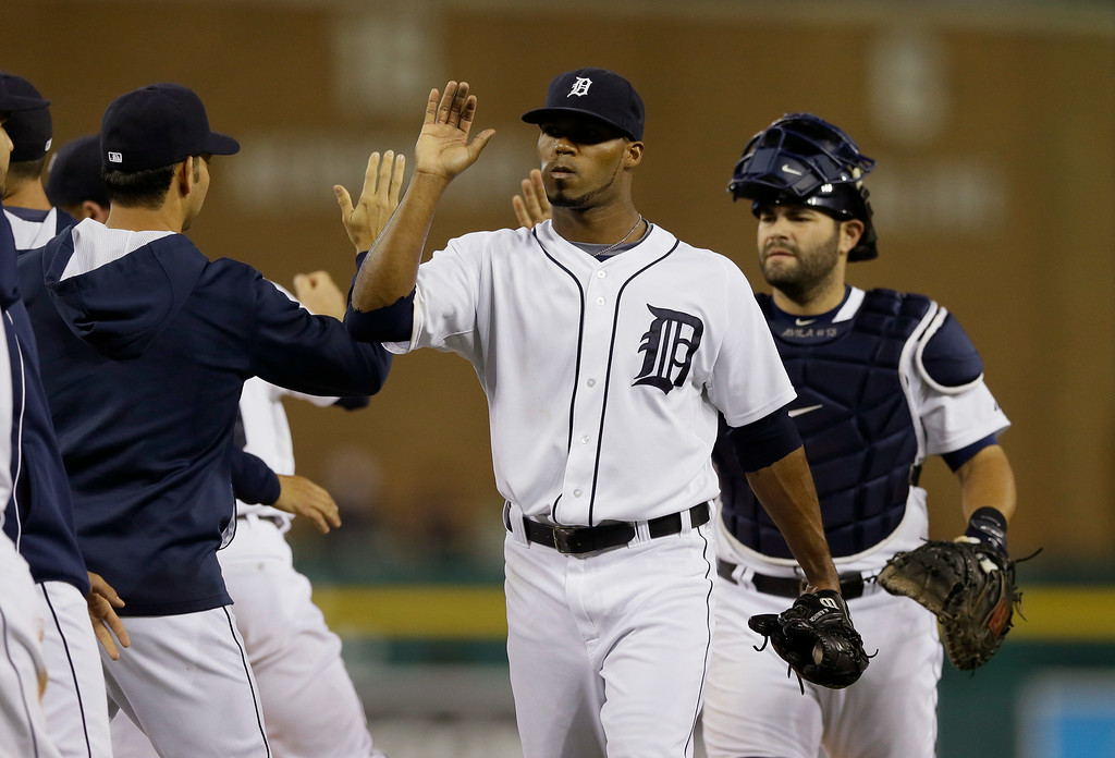 . Detroit Tigers relief pitcher Al Alburquerque and catcher Alex Avila greet teammates after their 7-2 win over the Chicago White Sox in a baseball game, Wednesday, July 30, 2014 in Detroit. (AP Photo/Carlos Osorio)