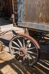 Front wheel and corner of a old wagon