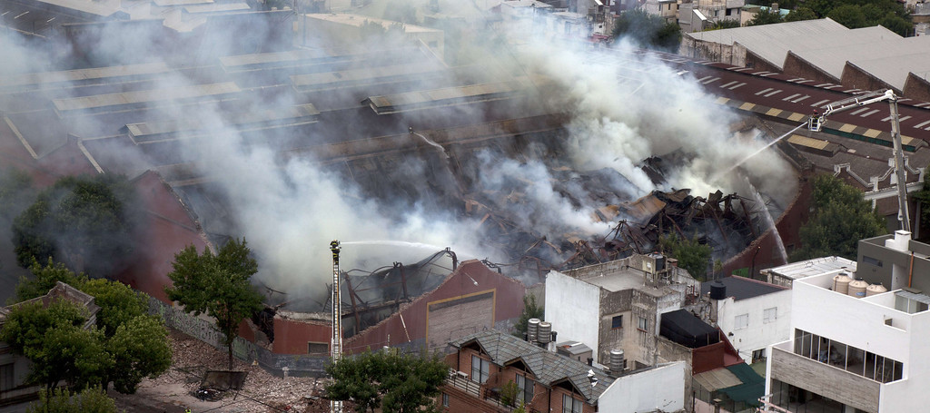 . Aerial view of a fire at a warehouse in Barracas, in southern Buenos Aires, on February 5, 2014.  AFP PHOTO / NICOLAS Garcia/AFP/Getty Images