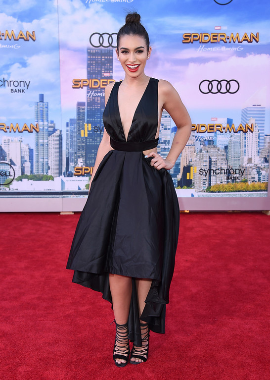 """. Ashley Iaconetti arrives at the Los Angeles premiere of \""""Spider-Man: Homecoming\"""" at the TCL Chinese Theatre on Wednesday, June 28, 2017. (Photo by Jordan Strauss/Invision/AP)"""