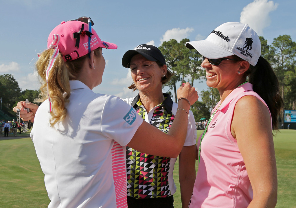 . Juli Inkster, center, is hugged by Paula Creamer, left, and Nicole Castrale, right, after leaving the 18th hole during the final round of the U.S. Women\'s Open golf tournament in Pinehurst, N.C., Sunday, June 22, 2014. (AP Photo/Chuck Burton)