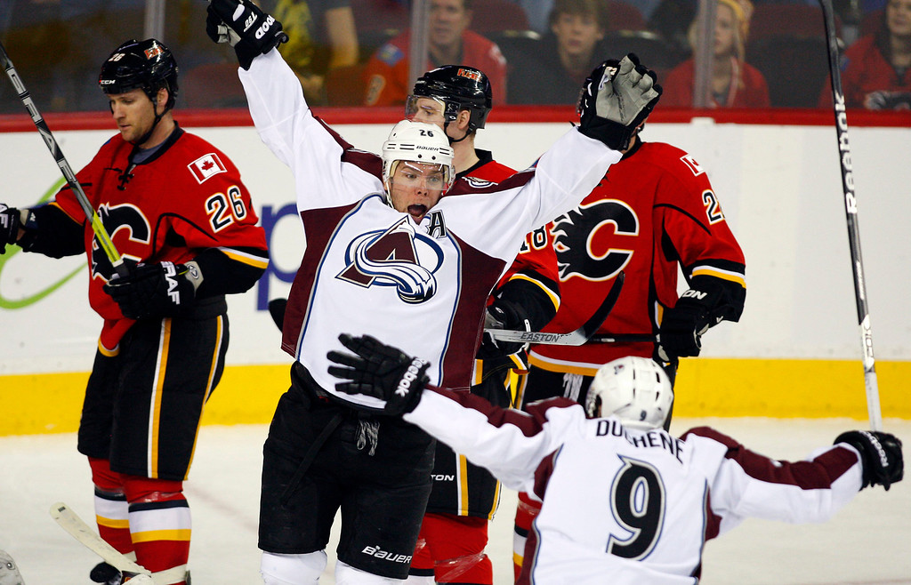 . Colorado Avalanche\'s Paul Stastny, center, celebrates his goal with teammate Matt Duchene, right, as Calgary Flames players skate past during the third period of an NHL hockey game Thursday, Jan. 31, 2013, in Calgary, Alberta. The Avalanche won 6-3. (AP Photo/The Canadian Press, Jeff McIntosh)