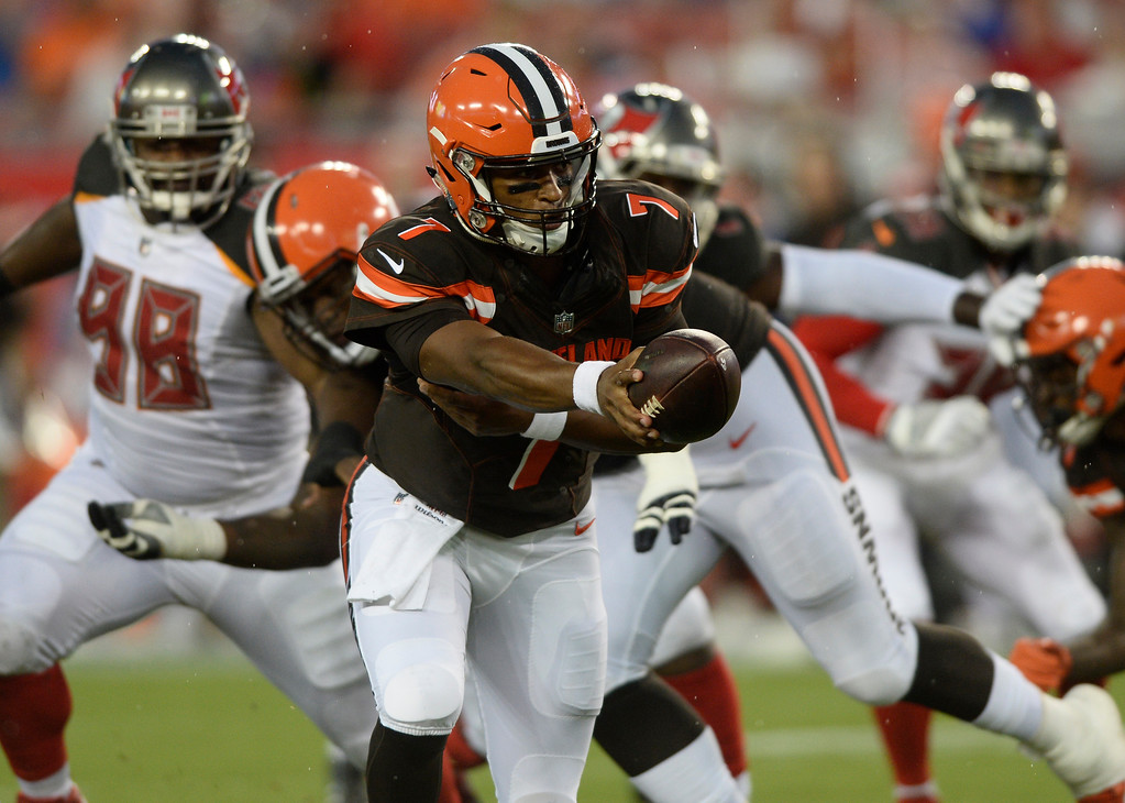 . Cleveland Browns quarterback DeShone Kizer looks to handoff against the Tampa Bay Buccaneers during the first quarter of an NFL preseason football game Saturday, Aug. 26, 2017, in Tampa, Fla. (AP Photo/Jason Behnken)