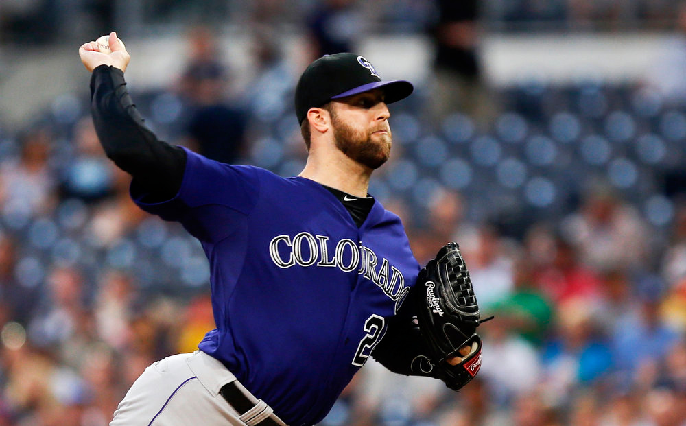 . Colorado Rockies starting pitcher Jordan Lyles works against the San Diego Padres in the first inning of a baseball game Monday, Aug. 11, 2014, in San Diego. (AP Photo/Lenny Ignelzi)