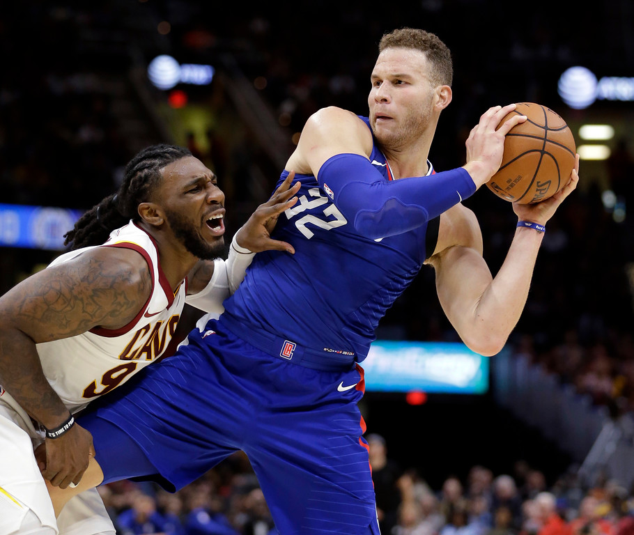 . Los Angeles Clippers\' Blake Griffin, right, knees Cleveland Cavaliers\' Jae Crowder in the groin during the second half of an NBA basketball game, Friday, Nov. 17, 2017, in Cleveland. The Cavaliers won 118-113 in overtime. (AP Photo/Tony Dejak)