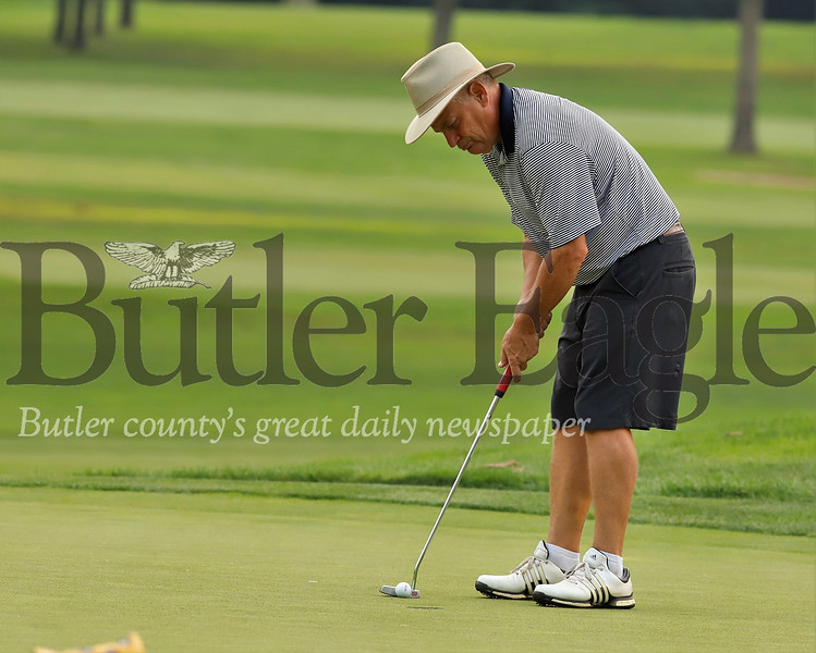 David Brown putts on hole No. 8 Tuesday at Butler Country Club.  Seb Foltz/ Butler Eagle
