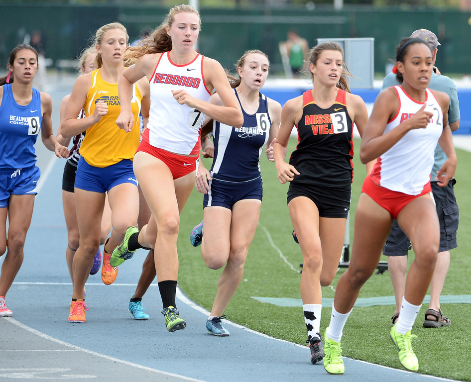 . Redondo\'s Anevay Hiehle (7) along with Redlands\'s Claire Crowley, center, competes in the division 2 800 meters race during the CIF Southern Section track and final Championships at Cerritos College in Norwalk, Calif., Saturday, May 24, 2014.   (Keith Birmingham/Pasadena Star-News)