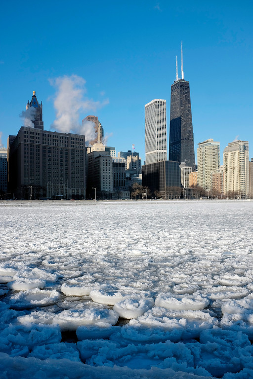 . Ice forms on Lake Michigan near Ohio Street Beach, Monday, Dec. 19, 2016, in downtown Chicago. Lingering arctic air and wind also has combined for dangerous subzero wind chills, though the National Weather Service forecast calls for temperatures to warm into the upper teens and twenties during the day. (AP Photo/Kiichiro Sato)
